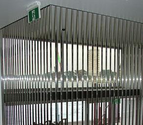 Floor to ceiling stainless steel room dividers